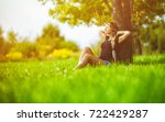 young hippie girl sitting under ... | Shutterstock . vector #722429287