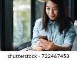young asian woman using... | Shutterstock . vector #722467453