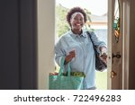 smiling african woman walking... | Shutterstock . vector #722496283