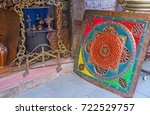 Small photo of The retro metalwork constructions in antique store of the metalware market - mirror frame, tableware and the colored decorative screen, Antalya, Turkey.