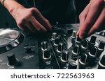 dj mixing music with blue light.... | Shutterstock . vector #722563963