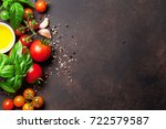 tomatoes  basil and spices on... | Shutterstock . vector #722579587
