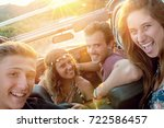 group of happy people in a car... | Shutterstock . vector #722586457