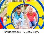kids on playground | Shutterstock . vector #722596597