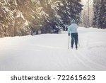 winter ski walks in the forest | Shutterstock . vector #722615623