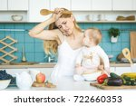 young mother with her baby... | Shutterstock . vector #722660353