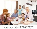 an elderly woman serves a salad ... | Shutterstock . vector #722662993