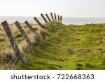 green grass with wooden post...