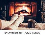 feet in woollen socks by the... | Shutterstock . vector #722746507