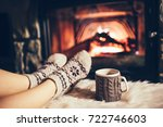 feet in woollen socks by the... | Shutterstock . vector #722746603