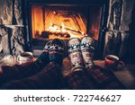 feet in woollen socks by the... | Shutterstock . vector #722746627