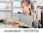 schoolgirl  repairing the...   Shutterstock . vector #722755723