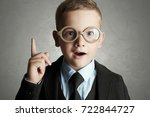 funny child in glasses and suit.... | Shutterstock . vector #722844727