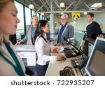 staff checking passport on... | Shutterstock . vector #722935207