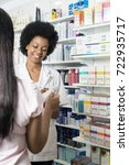 pharmacist showing product to... | Shutterstock . vector #722935717