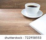 open book on a wooden texture... | Shutterstock . vector #722958553