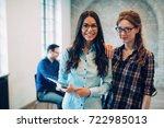 colleagues having coffee break... | Shutterstock . vector #722985013