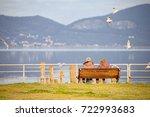 Elderly Couple Sitting On A...