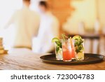 two cocktail glasses on tray on ... | Shutterstock . vector #723004783