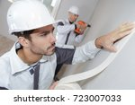 painter worker protecting wall... | Shutterstock . vector #723007033