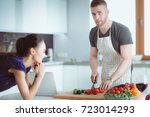 young man cutting vegetables... | Shutterstock . vector #723014293