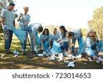 volunteering  charity  people... | Shutterstock . vector #723014653