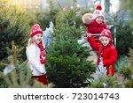 family selecting christmas tree.... | Shutterstock . vector #723014743