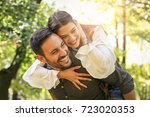 young coupe in park. boyfriend... | Shutterstock . vector #723020353
