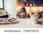 charming little girl on kitchen ... | Shutterstock . vector #723072913