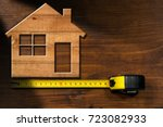 wooden model house on a wooden... | Shutterstock . vector #723082933