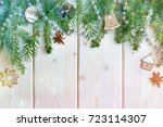 spruce branches on wooden... | Shutterstock . vector #723114307