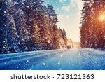 car tires on winter road... | Shutterstock . vector #723121363