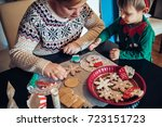cute boy and a woman decorating ... | Shutterstock . vector #723151723