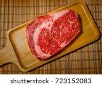wagyu beef on chopping board.... | Shutterstock . vector #723152083