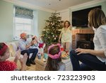 family are playing charades at... | Shutterstock . vector #723223903