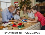 family are playing board games...   Shutterstock . vector #723223933
