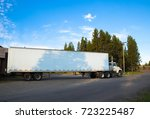 side view of white truck with