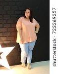 stunning fat girl with velvety... | Shutterstock . vector #723269257