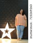 stunning fat girl with velvety... | Shutterstock . vector #723269263
