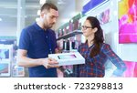 in the electronics store... | Shutterstock . vector #723298813