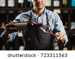 male sommelier pouring red wine ...   Shutterstock . vector #723311563