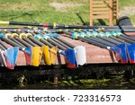 rowing oars drying on the pier | Shutterstock . vector #723316573