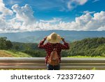 woman traveler with backpack... | Shutterstock . vector #723372607
