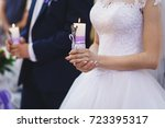 Bride And Groom Holding Candle...