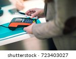 man using mobile phone to pay... | Shutterstock . vector #723403027