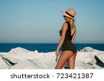 beautiful girl in a black... | Shutterstock . vector #723421387