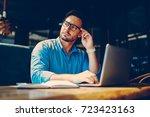 pensive handsome businessman... | Shutterstock . vector #723423163