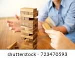 group of friends playing blocks ... | Shutterstock . vector #723470593