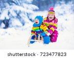 little girl and boy enjoy a... | Shutterstock . vector #723477823