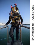 commercial diver entering the... | Shutterstock . vector #723537283